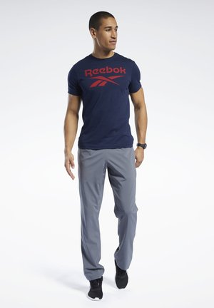 TRAINING ESSENTIALS WOVEN UNLINED PANTS - Tracksuit bottoms - grey