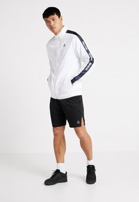 Reebok - TRAINING TRACK JACKET - Veste de survêtement - white - 1