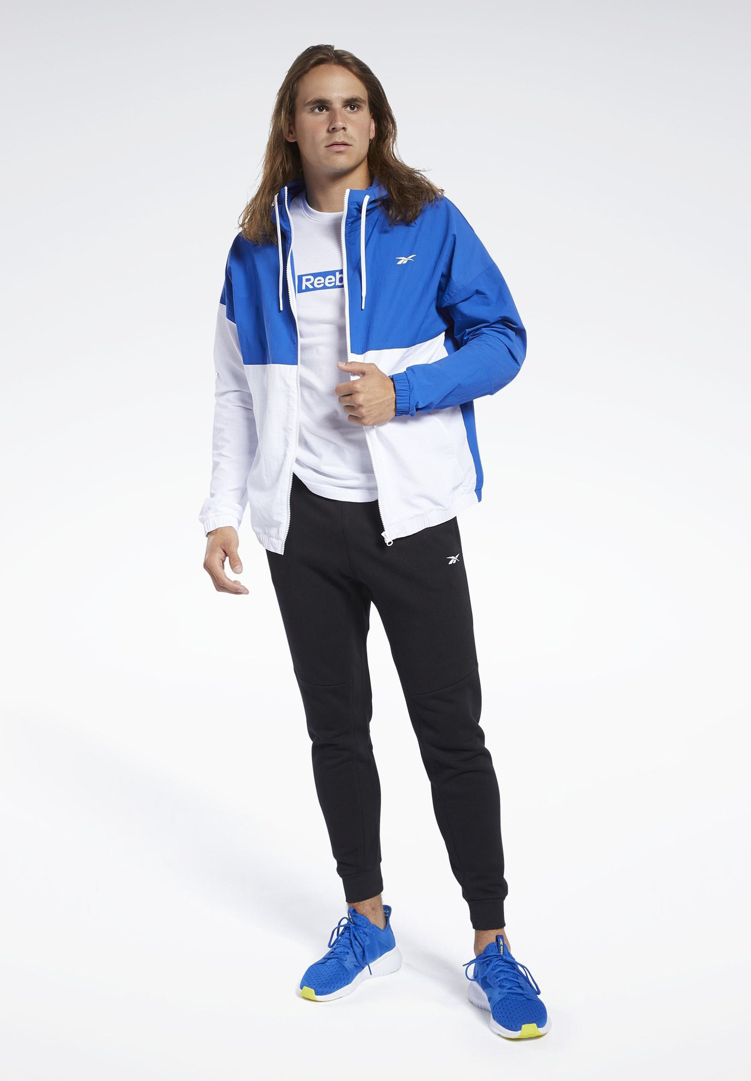 Reebok TRAINING ESSENTIALS WINDBREAKER - Training jacket - humble blue