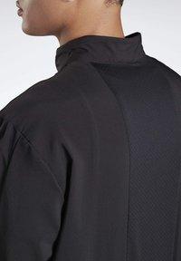 Reebok - RUNNING ESSENTIALS WIND JACKET - Sports jacket - black - 3