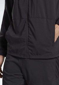 Reebok - RUNNING ESSENTIALS WIND JACKET - Sports jacket - black - 4