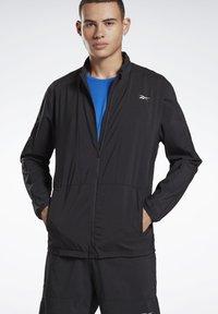 Reebok - RUNNING ESSENTIALS WIND JACKET - Sports jacket - black - 0