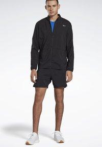Reebok - RUNNING ESSENTIALS WIND JACKET - Sports jacket - black - 1