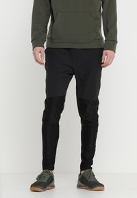Reebok - OST TRACKSTER - Trousers - black - 0