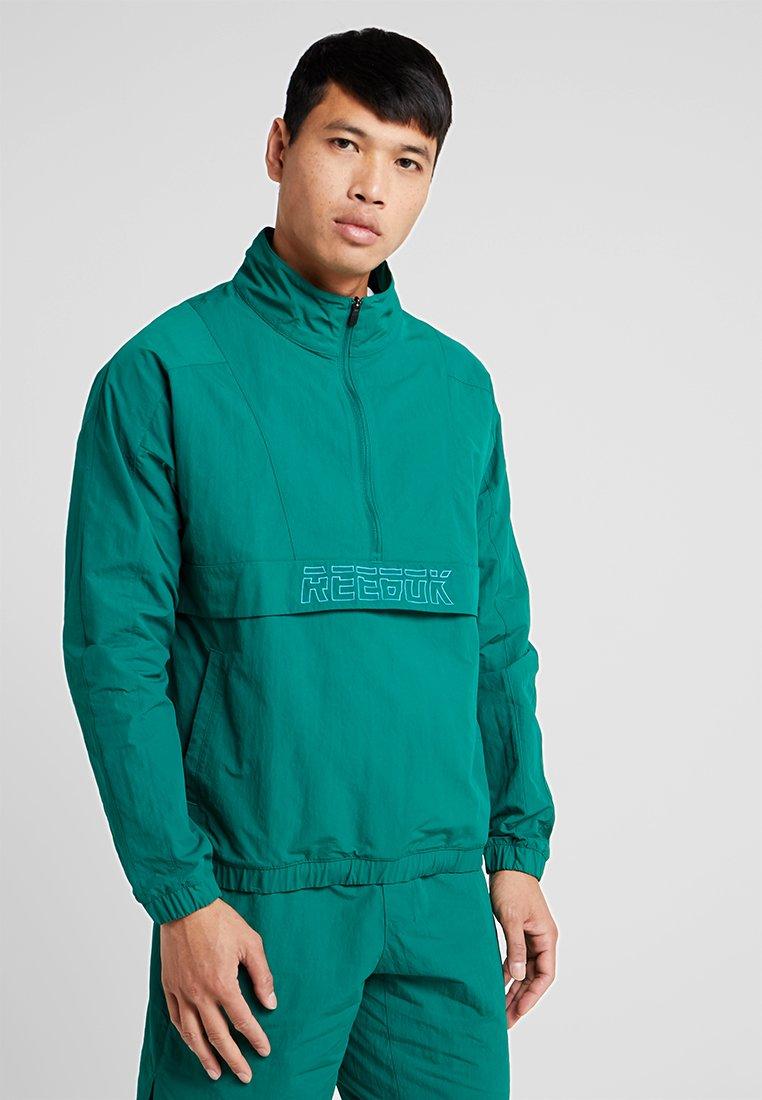 Reebok - MEET YOU THERE 1/2 ZIP JACKET - Sportovní bunda - green