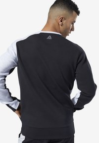 Reebok - ONE SERIES TRAINING COLORBLOCK SWEATSHIRT - Sweatshirt - black - 1