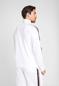 Reebok - WORKOUT READY TRAINING LONG SLEEVE T-SHIRT - Pitkähihainen paita - white - 2