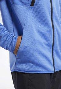 Reebok - SPEEDWICK HOODIE - Training jacket - blue - 5