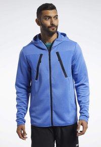 Reebok - SPEEDWICK HOODIE - Training jacket - blue - 0