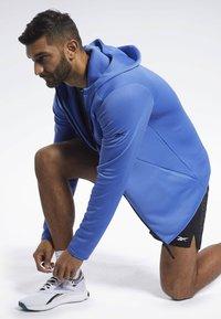 Reebok - SPEEDWICK HOODIE - Training jacket - blue - 1