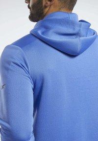 Reebok - SPEEDWICK HOODIE - Training jacket - blue - 4