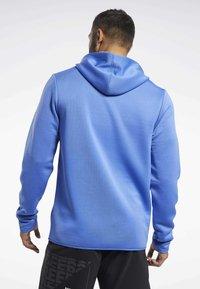 Reebok - SPEEDWICK HOODIE - Training jacket - blue - 2