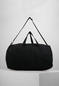 Reebok - ACT CORE GRIP - Sports bag - black/medium grey - 2