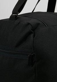 Reebok - ACT CORE GRIP - Sports bag - black/medium grey - 7