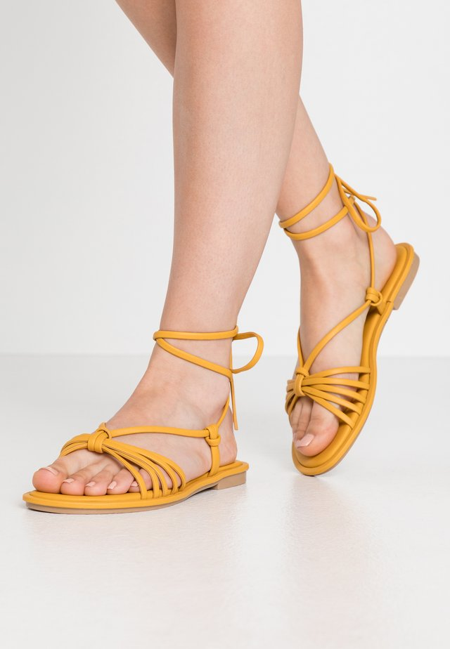 NETTA - Sandals - dark yellow