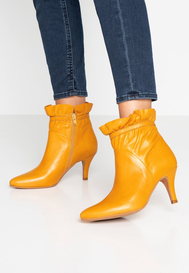 CINDA - Classic ankle boots - yellow