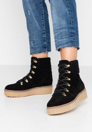 FIA - Platform ankle boots - black