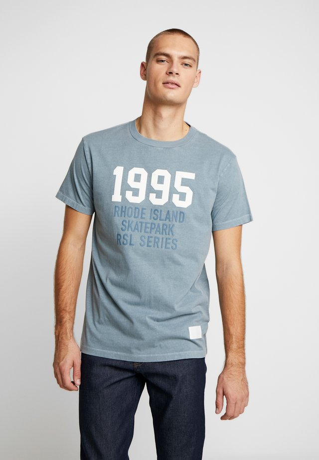 T-shirt med print - teal