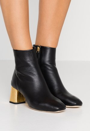 MELO - Classic ankle boots - noir/or