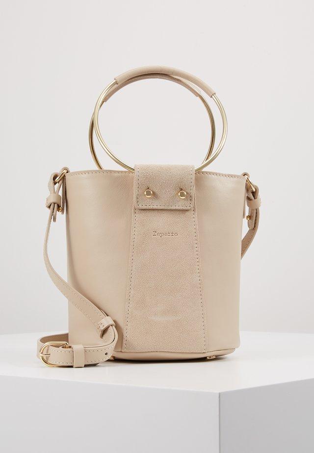 MANEGE - Handtasche - beige