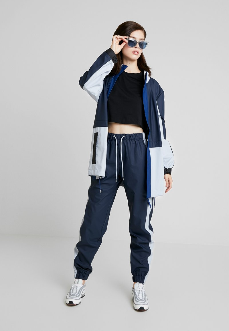 Rains - LIMITED EDITION COLOR BLOCK  - Trousers - blue/ice grey