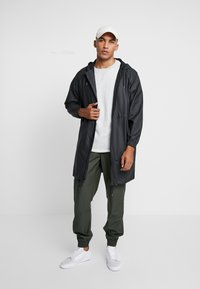 Rains - UNISEX LONG JACKET - Parka - black - 1