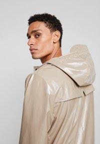 Rains - HOLOGRAPHIC JACKET - Waterproof jacket - beige - 4