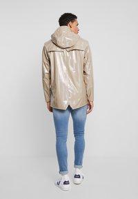 Rains - HOLOGRAPHIC JACKET - Waterproof jacket - beige - 2