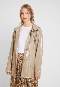 Rains - HOLOGRAPHIC JACKET - Waterproof jacket - beige - 3