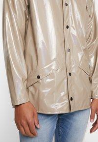 Rains - HOLOGRAPHIC JACKET - Waterproof jacket - beige - 6