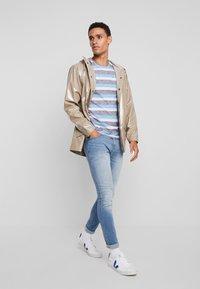 Rains - HOLOGRAPHIC JACKET - Waterproof jacket - beige - 1