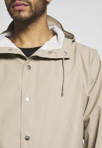 Rains - UNISEX LONG JACKET - Vodotěsná bunda - beige - 4