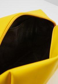 Rains - WASH BAG SMALL - Kosmetiktasche - yellow - 5