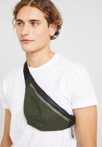 Rains - COLOR BLOCK BUM BAG MINI - Bum bag - green/black - 1