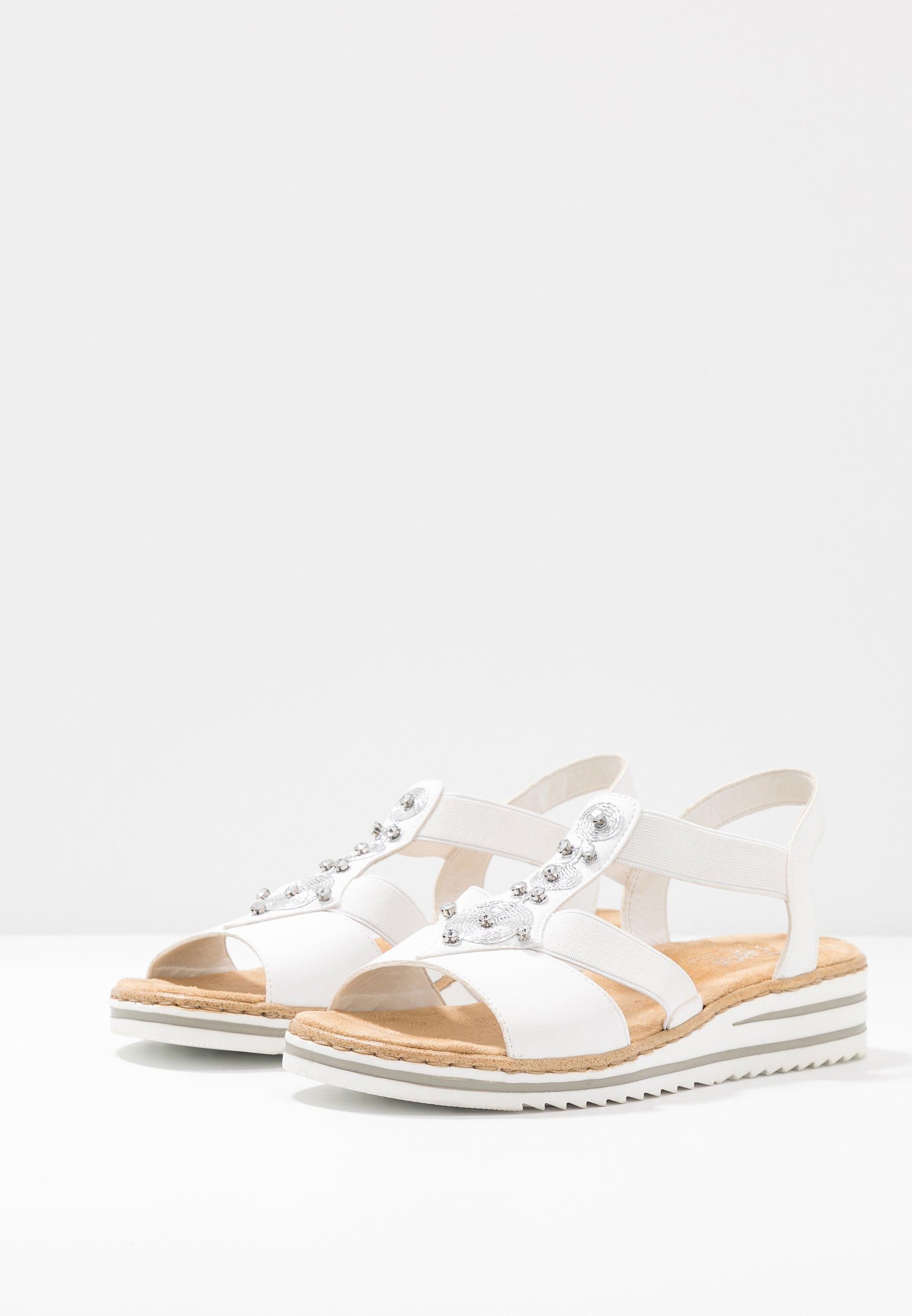 Korkeakorkoiset sandaalit weiß