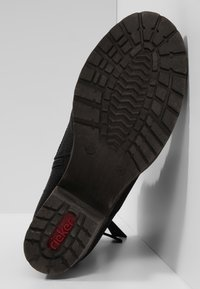 Rieker - Classic ankle boots - black - 5