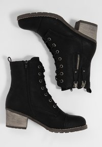 Rieker - Classic ankle boots - black - 2