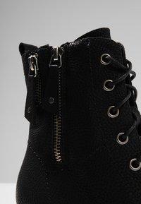 Rieker - Classic ankle boots - black - 6