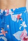 Rip Curl - INFUSION FLOWER PANTS - Strandaccessoire - brilliant blue