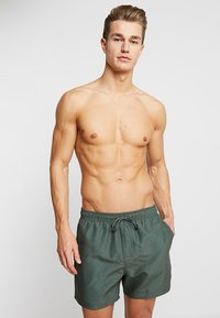 Rip Curl - VOLLEY - Swimming shorts - dark olive - 0