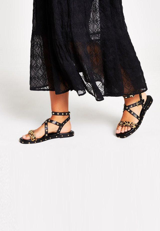 POPPY - Sandaalit nilkkaremmillä - black