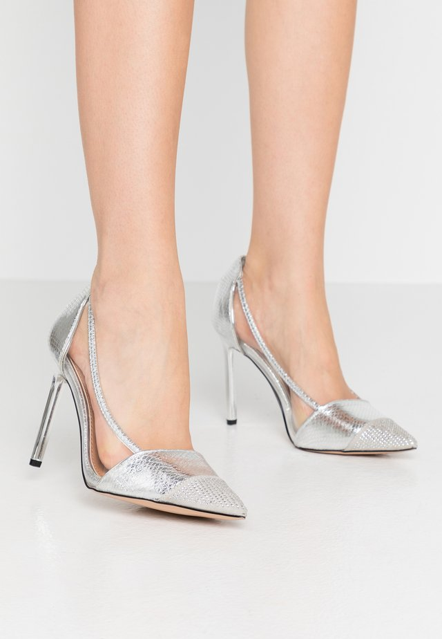 Klassiska pumps - silver