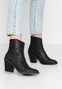 River Island - Kotníková obuv na vysokém podpatku - black - 0