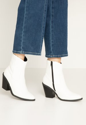 Bottines à talons hauts - white