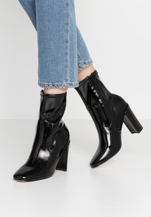 High heeled ankle boots - black bright