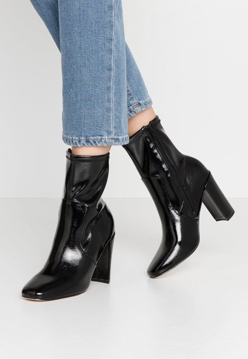 River Island - High heeled ankle boots - black bright