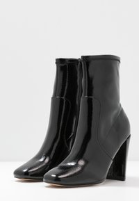 River Island - High heeled ankle boots - black bright - 4
