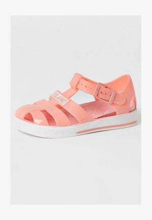 Sandaalit nilkkaremmillä - orange