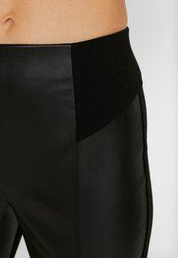 River Island - PONTE HYBRID RITA - Trousers - black - 4