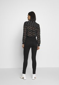 River Island - HAILEY - Jeans Skinny Fit - black - 2